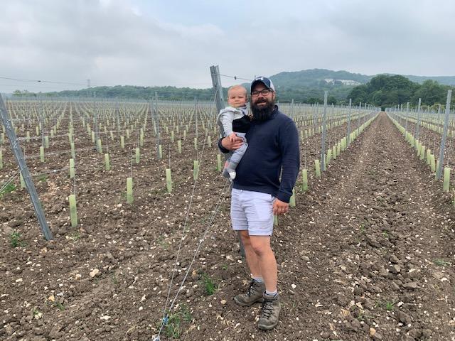Luke Wolfe with son in vineyard
